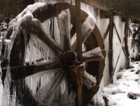 Iced over water wheel